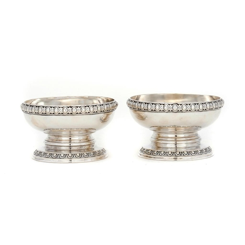 530 - A PAIR OF GEORGE IV SILVER SALT CELLARS BY PAUL STORR with strapwork and egg and dart rims, crested,...