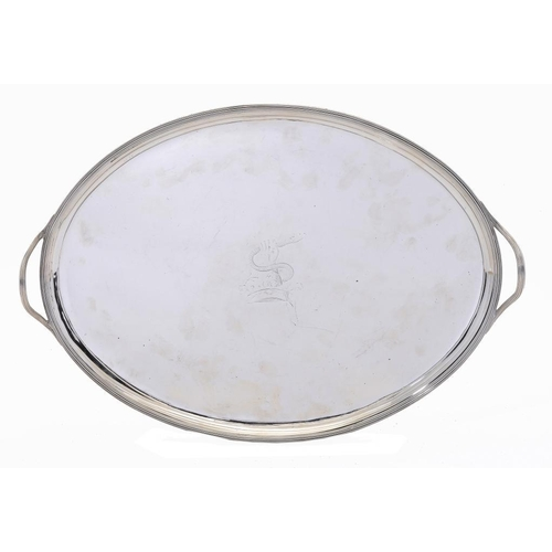 537 - A GEORGE III SILVER TEA TRAY with reeded handles and rim, crested, 51cm w, by Elizabeth Jones, Londo...