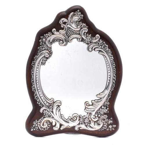 540 - A VICTORIAN SILVER ROCOCO REVIVAL MIRROR backed on mahogany, 40cm h, maker's mark poorly struck, Lon...