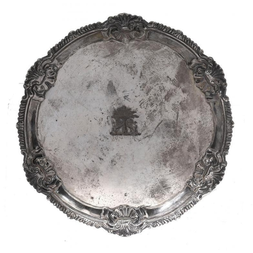 541 - YORK SILVER.  A GEORGE III GADROONED WAITER  the rim with shells at intervals, on three feet, creste...