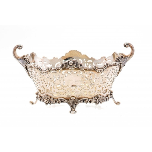 543 - A VICTORIAN PIERCED SILVER FRUIT BOWL with flying scroll handles, 19cm w, by The Goldsmiths & Silver...