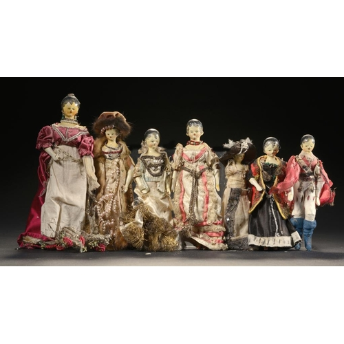 94 - <p>SEVEN SIMILAR PAINTED WOODEN PEG DOLLS IN CONTEMPORARY DRESS, LATE 19TH C  17-22cm h</p><p></p>...