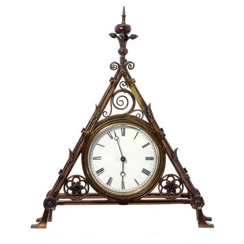 6 - <p>A VICTORIAN GOTHIC BRASS CLOCKCASE DESIGNED BY BRUCE TALBERT, THE MANUFACTURE ATTRIBUTED TO COX &...