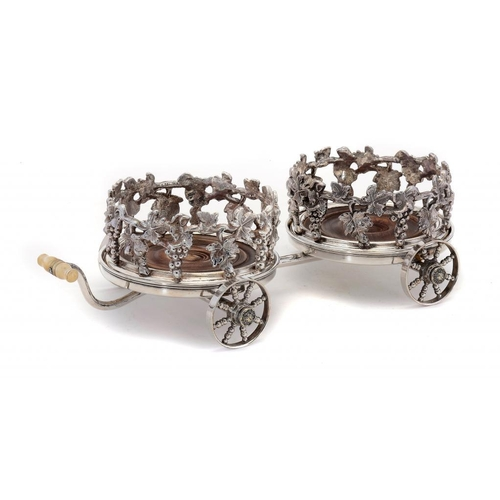 610 - <p>A VICTORIAN STYLE DECANTER WAGON, 19TH C with a pair of grapevine bordered wine coasters, turned ...