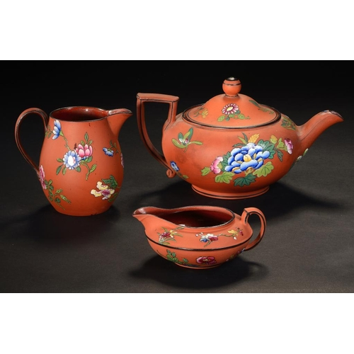 69 - <p>TWO WEDGWOOD  ROSSO ANTICO  CREAM JUGS, C1840 AND A MATCHING WEDGWOOD TEAPOT AND COVER, 1865  ena...