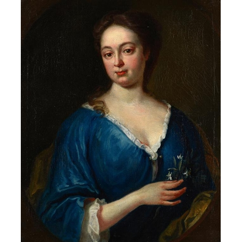737 - <p>CIRCLE OF WILLIAM AIKMAN PORTRAIT OF A LADY  bust length in a blue dress, holding a sprig of whit...
