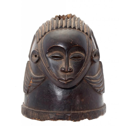 926 - <p>TRIBAL ART.  A HELMET MASK, IGALA PEOPLE, NIGERIA, 19TH/20TH C  of carved and smoothed, stained w...