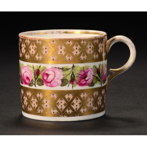 93 - <p>A DERBY COFFEE CAN, C1800 painted with a band of roses between bloom and gilt trellis borders, 5....