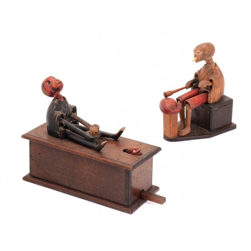 932 - <p>TWO JAPANESE CARVED AND PAINTED WOOD MECHANICAL KOBE TOYS, EARLY 20TH C in the form of man startl...