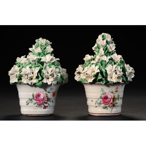 94 - <p>A PAIR OF DERBY FLOWER POTS, C1765 the hooped pots painted with loose bouquets and scattered flow...