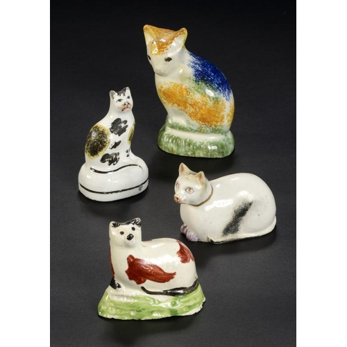 22 - <p>A PRATT WARE MODEL OF A CAT, A SMALLER CREAMWARE MODEL OF A CAT AND TWO STAFFORDSHIRE PORCELAIN M...