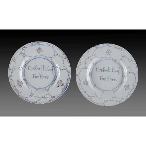 30 - <p>A PAIR OF BRISTOL DELFTWARE PLATES, C1750-60  in a slightly bluish glaze and inscrived in blue Cr...