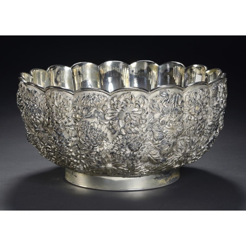 305 - <p>A JAPANESE SILVER PLATED KIKU MOULDED PUNCH BOWL, MEIJI PERIOD, C1890-1900  decorated in crisp re...