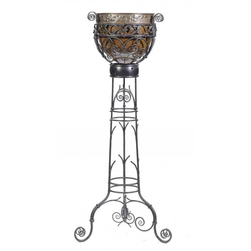 5 - <p>AN ARTS & CRAFTS COPPER JARDINIERE ON  WROUGHT IRON TRIPOD STAND, C1925  159cm h</p><p></p>...
