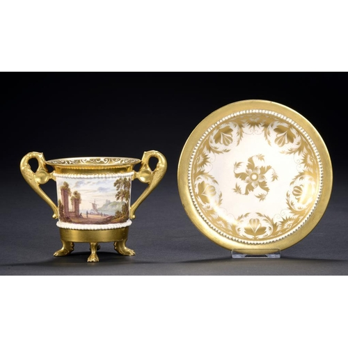 75 - A DERBY TWO HANDLED CABINET CUP AND STAND, C1820 the cup painted to either side with a wooded landsc...