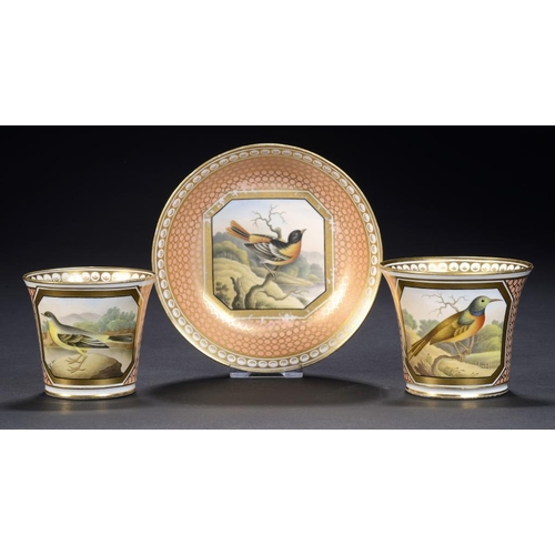 76 - A CHAMBERLAIN WORCESTER TRIO, C1805-10  finely painted with a octagonal gilt panel of a bird, saucer...