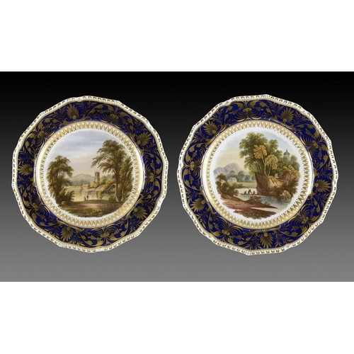 90 - A PAIR OF DERBY PLATES, C1820  painted possibly by Daniel Lucas with landscapes, 22cm diam, painted ...