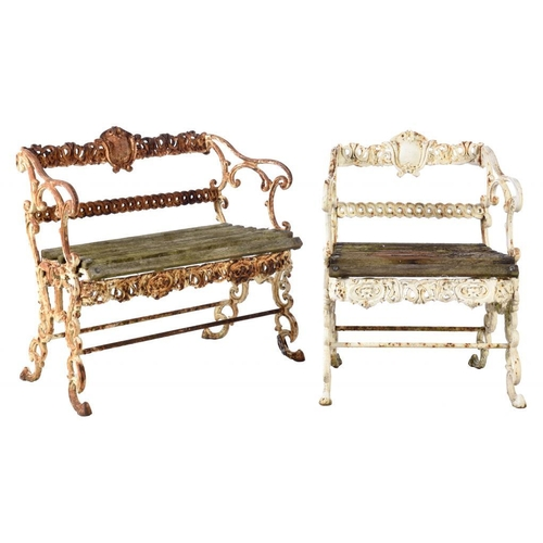 951 - AN ENGLISH CAST IRON ROCOCO REVIVAL GARDEN SEAT AND MATCHING ARMCHAIR,  20TH C  88 and 66cm w...
