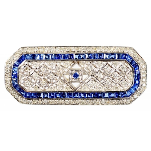 13 - <p>A DIAMOND AND SAPPHIRE BROOCH   of octagonal form with trellis centre, in white gold, marked 18K,...