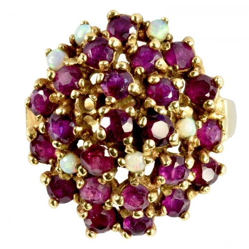15 - <p>A RUBY AND OPAL CLUSTER RING  in 9ct gold, 7.4g, Size O</p><p></p>...