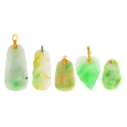 18 - <p>FIVE SOUTH EAST ASIAN CARVED JADE AND JADEITE PENDANTS  three gold mounted, 3-5cm </p><p></p>...
