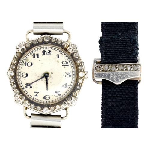 26 - <p>A SWISS DIAMOND COCKTAIL WATCH  in platinum, quartz movement, 2cm diam, associated metal bracelet...