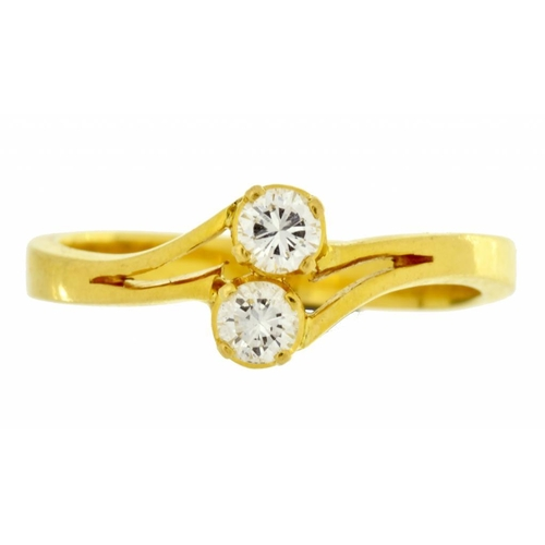 31 - <p>A DIAMOND CROSSOVER RING  with round brilliant cut diamonds, in gold, marked in Chinese, 3.8g, si...