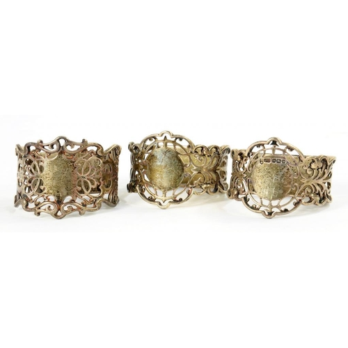 508 - ONE AND A PAIR OF  GEORGE V PIERCED SILVER NAPKIN RINGS   by Joseph Rodgers & Sons Ltd, Sheffield 19...