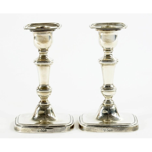 515 - A PAIR OF GEORGE V SILVER CANDLESTICKS  16cm h, by Hawksworth,  Eyre & Co Ltd, Sheffield 1925, loade...