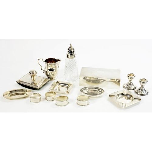 517 - MISCELLANEOUS SILVER ARTICLES  comprising a cigarette box, cedar lined, rocking blotter, cream jug, ...