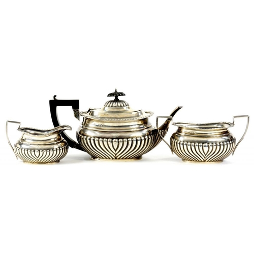 524 - A GEORGE V SILVER TEA SERVICE  with gadrooned rim, teapot 13cm h, by Reid & Sons, London 1912 and 13...