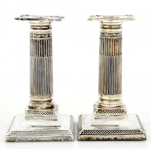 526 - A PAIR OF VICTORIAN SILVER DWARF COLUMNAR CANDLESTICKS  with nozzles, 15cm h, by Henry Wilkinson & C...
