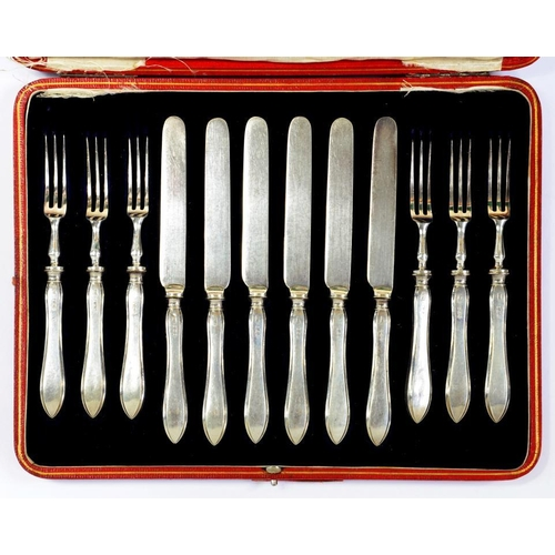 529 - A SET OF SIX GEORGE V SILVER HAFTED DESSERT KNIVES AND FORKS  by R R Mosley & Co Ltd, Sheffield 1915...