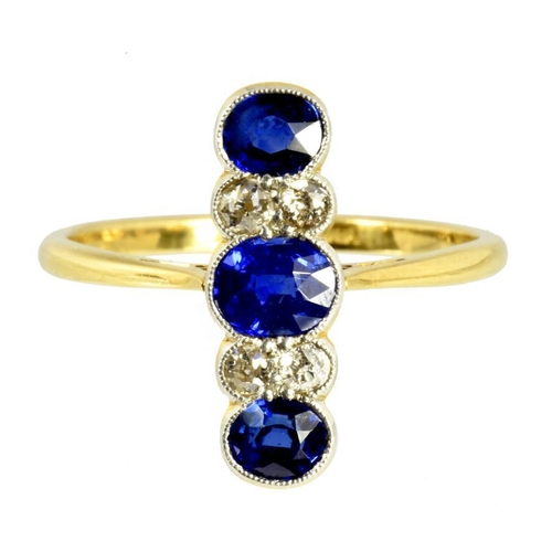 8 - <p>A SAPPHIRE AND DIAMOND RING  with three larger oval sapphires and six old cut diamonds,  millegra...