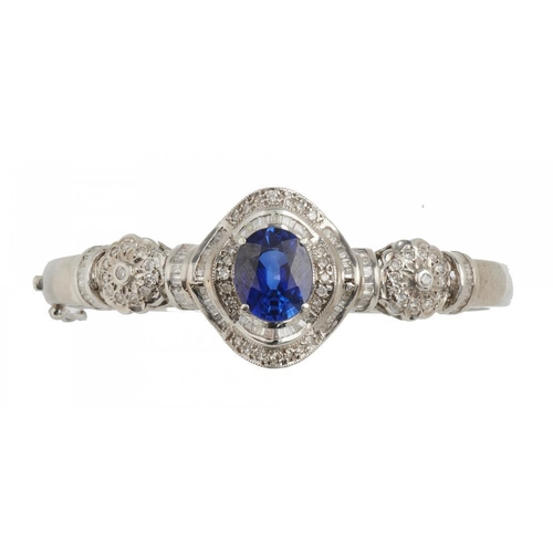 23 - <p>A SAPPHIRE AND DIAMOND BANGLE, the baguette and brilliant cut diamonds approx 1.5 ct, the oval fa...