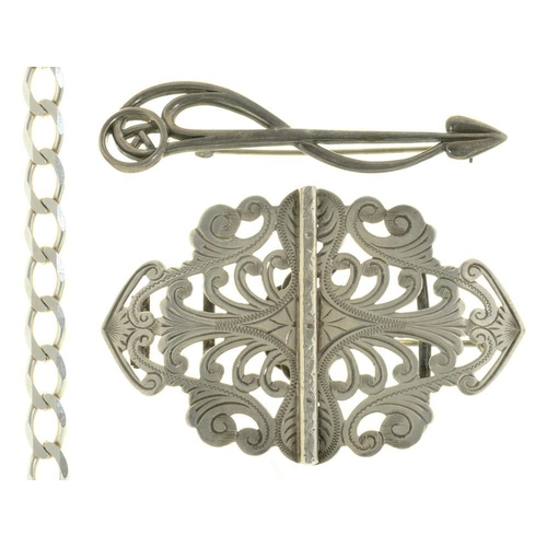 43 - <p>AN EDWARDIAN SILVER BUCKLE, BIRMINGHAM 1906, CONVERTED TO A BROOCH, ANOTHER SILVER BROOCH AND A S...