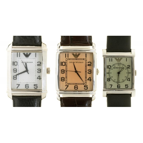 52 - <p>TWO ARMANI STAINLESS STEEL GENTLEMAN'S WRISTWATCHES AND AN ARMANI STAINLESS STEEL LADY'S WRISTWAT...