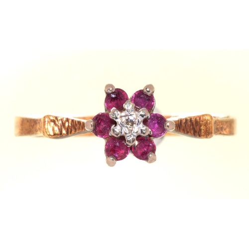 8C - <p>A DIAMOND AND RUBY CLUSTER RING IN 18CT GOLD, LONDON 1972, 2.85G, SIZE L</p><p></p>...