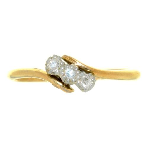 9 - <p>A THREE STONE DIAMOND CROSSOVER RING IN 18CT GOLD, BIRMINGHAM 1938, 2.5G, SIZE N�</p><p></p>...