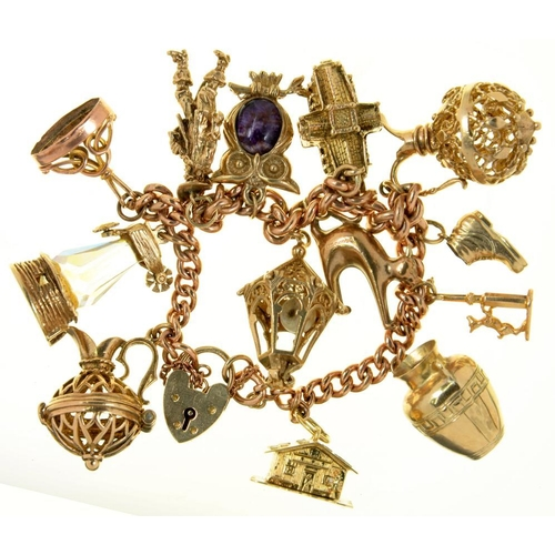 12 - <p>A 9CT GOLD CHARM BRACELET WITH A COLLECTION OF CHARMS, ELEVEN IN  9CT GOLD, ONE IN GOLD MARKED 58...