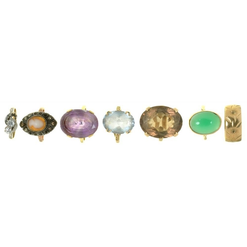 13 - <p>SEVEN RINGS, INCLUDING AN AMETHYST RING IN 9CT GOLD, A SMOKY QUARTZ RING IN GOLD MARKED 9CT, AND ...