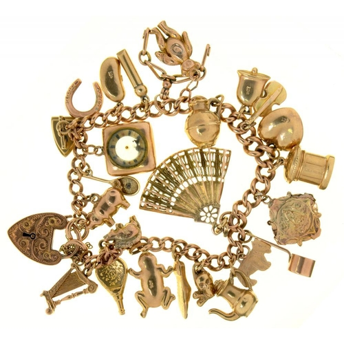 26 - <p>A 9CT GOLD CHARM BRACELET, LINKS INDIVIDUALLY MARKED, WITH A COLLECTION OF GOLD CHARMS, 36G</p><p...