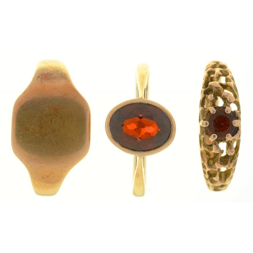 12 - <p>THREE GOLD RINGS, TWO SET WITH GARNETS, MARKED 9CT, SIZES N - T, 7G</p><p></p>...