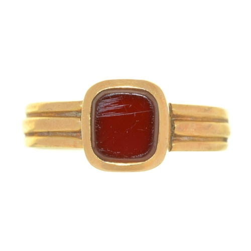 27 - <p>A CORNELIAN RING, IN REEDED 18CT GOLD HOOP, BIRMINGHAM 1887, SIZE N, 3G</p><p></p>...