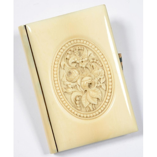 293 - <p>A VICTORIAN CARVED IVORY BOOK FORM AIDE MEMOIRE, THE UPPER BOARD FINELY CARVED IN SHALLOW RELIEF ...