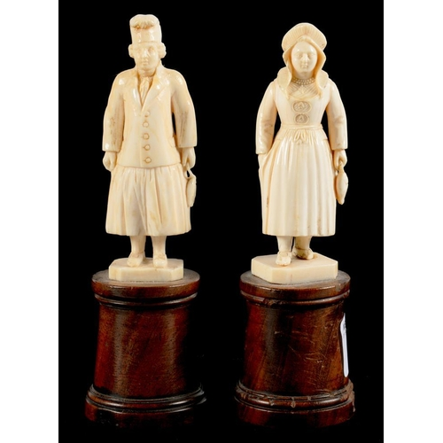 306 - <p>A PAIR OF CONTINENTAL MINIATURE IVORY STATUETTES OF A MAN AND WOMAN, PROBABLY DIEPPE, ON TURNED W...