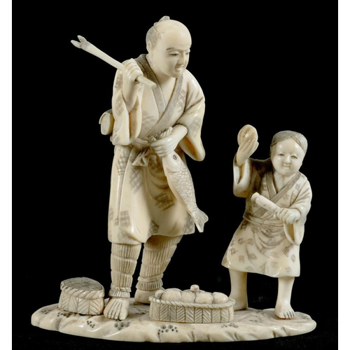 307 - <p>A JAPANESE IVORY OKIMONO OF A FISHERMAN AND HIS SON, 10.5CM H, SIGNED IN RED, MEIJI PERIOD </p>...