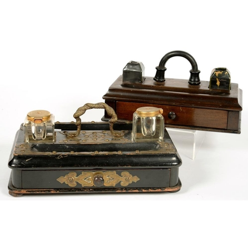 323 - <p>A VICTORIAN EBONISED INKSTAND WITH APPLIED STUDDED BRASS STRAPWORK AND A PAIR OF GLASS INKWELLS, ...