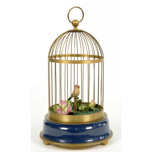 324 - <p>A BRASS AND PATINATED METAL CLOCKWORK SINGING BIRD-IN-A-CAGE AUTOMATON, 32CM H, 20TH C </p>...