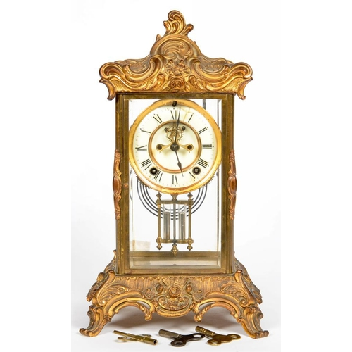 337 - <p>AN ORNATE FRENCH CAST GILTMETAL FOUR GLASS MANTEL CLOCK, WITH BROCOT ESCAPEMENT, ENAMEL DIAL AND ...